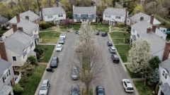 Vehicles parked outside residential homes in Manhasset, New York.