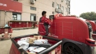 An employee loads packages into a delivery robot at a logistic center during a media tour of JD.com Inc.'s autonomous delivery vehicles in Changshu, Jiangsu province, China, on Thursday, Oct. 22, 2020. JD.com's vast logistics network is set to continue attracting international and domestic brands wanting to deepen their penetration of the Chinese market.