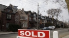 "A ""Sold sign"" in front of homes in the Midtown neighborhood of Toronto, Ontario, Canada, on Thursday, March 11, 2021. The buying, selling and building of homes in Canada takes up a larger share of the economy than it does in any other developed country in the world, according to the Bank of International Settlements, and also soaks up a larger share of investment capital than in any of Canada's peers. Photographer: Cole Burston/Bloomberg"