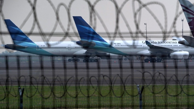 PT Garuda Indonesia aircraft parked at Soekarno-Hatta International Airport in Cengkareng, Indonesia, on Monday, May 24, 2021. Garuda Indonesia needs to completely restructure its business, potentially reducing the number of planes it operates to less than half its main fleet as the airline seeks to survive the crisis wrought by the pandemic, its president told staff last week.
