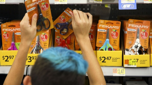 A child browses Fiskars OYJ ABP scissors school supplies displayed for sale at a Wal-Mart Stores Inc. location in Burbank, California, U.S., on Tuesday, Aug. 8, 2017. Wal-Mart Stores is scheduled to release earnings figures on August 17. Photographer: Patrick T. Fallon/Bloomberg