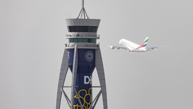 An Airbus SE A380-800 aircraft, operated by Emirates, takes off past the control tower at Dubai International Airport in Dubai, United Arab Emirates, on Monday, March 23, 2020. Dubai-based Emirates, the largest long-haul airline, and neighbor Etihad of Abu Dhabi will stop flying passengers for two weeks from Wednesday because of local restrictions.