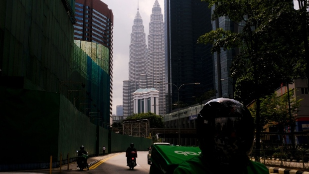 A near-empty street during a Movement Control Order in Kuala Lumpur, Malaysia, in August. Photographer: Samsul Said/Bloomberg