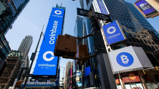 Monitors display Coinbase signage during the company's initial public offering (IPO) at the Nasdaq MarketSite in New York, U.S., on Wednesday, April 14, 2021. Coinbase Global Inc., the largest U.S. cryptocurrency exchange, is set to debut on Wednesday through a direct listing, an alternative to a traditional initial public offering that has only been deployed a handful of times. Photographer: Michael Nagle/Bloomberg