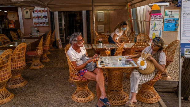 Tourists at an outdoor table of a restaurant in Lagos, Portugal, on May 30.