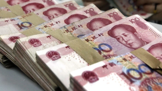 China Retains Borrowing Cost; Industrial Output Growth Eases