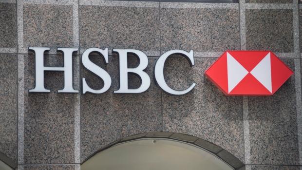 HSBC's $2 5-billion buy-back boosts shares as bank postpones profit