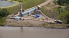 Husky crews work to clean up an oil spill on the North Saskatchewan river near Maidstone, Sask