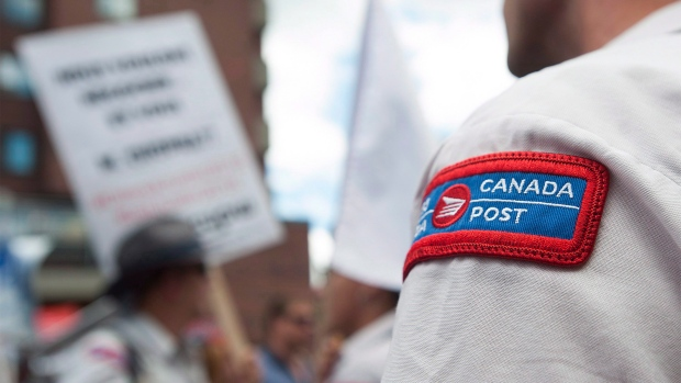 Canada Post workers demonstrate outside the riding office of Prime Minister Justin Trudeau
