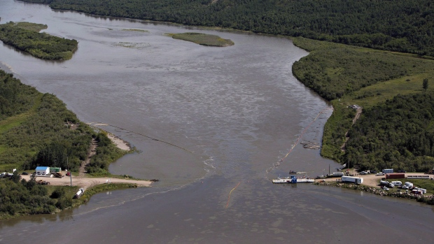 Crews work to clean up an oil spill on the North Saskatchewan river