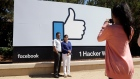 Facebook logo outside of the company's headquarters in Menlo Park , Calif.