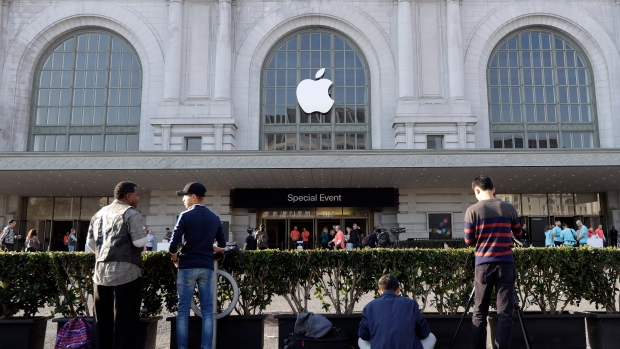 People wait outside the auditorium before Apple's product event, Sept. 7 2016 in San Francisco