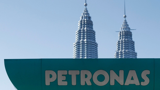 A Petronas gas station is pictured against Malaysia's landmark building, Petronas Twin Towers
