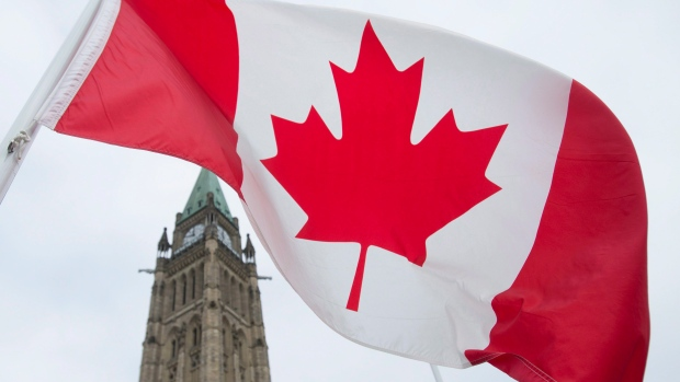 The Canadian flag flies on Parliament Hill