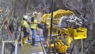 K92 CEO Ian Stalker underground with drill rig at Irumafimpa Gold Deposit