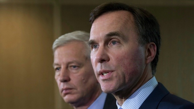 Chairman of the Advisory Council Dominic Barton and Minister of Finance Bill Morneau