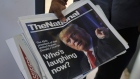 Newspapers with front page photos of U.S. President-elect Donald Trump in Dubai