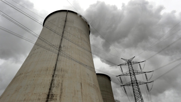 An electricity pylon stands next to a cooling tower at the LEAG (Lusatian Energy Stock Company) lign