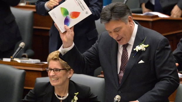 Ontario Finance Minister Charles Sousa, right, delivers the budget next to Premier Kathleen Wynne