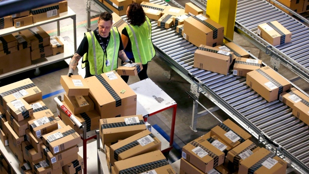 Amazon employees organize outbound packages on Cyber Monday