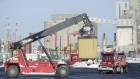 Trucks unload containers from cargo ships in the Port of Montreal