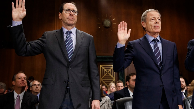 AT&T Chairman and CEO Randall Stephenson, left, and Time Warner Chairman and CEO Jeffrey Bewkes.