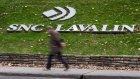 A man walks past the headquarters of SNC-Lavalin in Montreal
