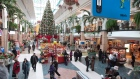 Christmas shoppers walk to stores at the Laurier shopping centre in Quebec City