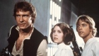 "Harrison Ford, Carrie Fisher, and Mark Hamill are shown in a scene from ""Star Wars"""