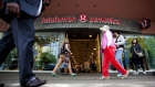 People walk pas Lululemon Athletica in downtown Vancouver June 11, 2014.