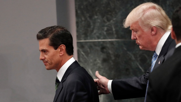 Donald Trump walks with Mexico President Enrique Pena Nieto in August
