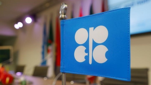 Oil edges down as OPEC sees market rebalancing at slower pace
