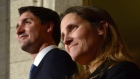 Prime Minister Justin Trudeau talks alongside Chrystia Freeland at a press conference