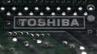 A logo of Toshiba Corp is seen on a printed circuit board
