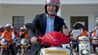 Travis Kalanick poses during the launch of Uber's bike-sharing product, uberMOTO