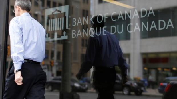 A man walks past the Bank of Canada office in Ottawa