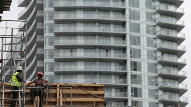 Construction workers chat on a condominium building site in Toronto, Ontario, Canada October 3, 2016