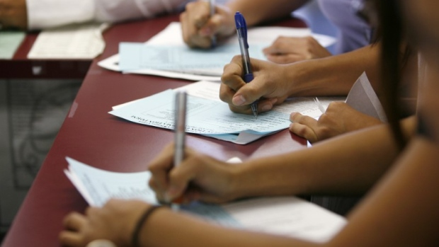 Applicants fill out forms during a job fair at the Southeast LA-Crenshaw WorkSource Center
