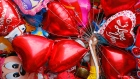 A vendor sells balloons on Valentine's Day, Tuesday, Feb.14, 2017,