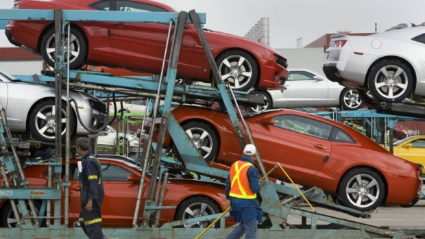 General Motors auto workers load the new Chevrolet Camaro for delivery, at the company's Oshawa Onta