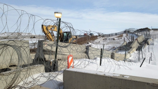 Razor wire and concrete barriers protect access to the Dakota Access pipeline drilling site.