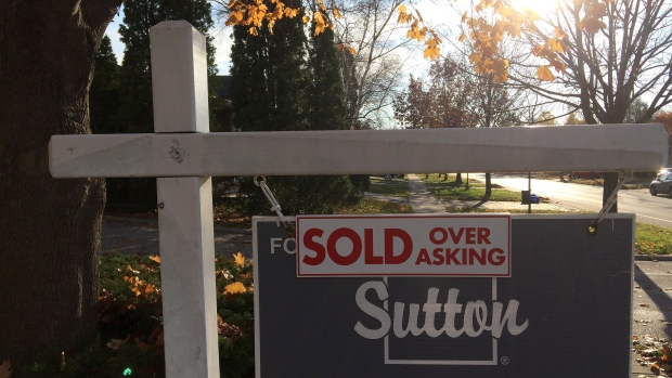 "A ""sold over asking"" sign is shown on a real estate sign in Oakville, Ont., Thursday, Nov.17, 2016."