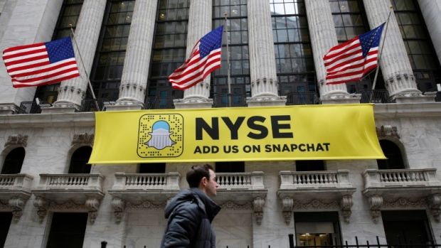 A Snapchat sign hangs on the facade of the New York Stock Exchange (NYSE) in New York City