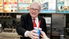 Warren Buffett hands out a Girl Scout Thin Mint Cookie Blizzard at a Dairy Queen in Omaha, Neb.