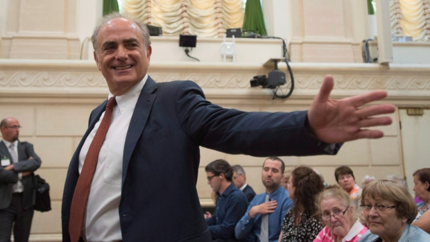 Air Canada CEO Calin Rovinescu gestures before a Commons official languages committee meeting
