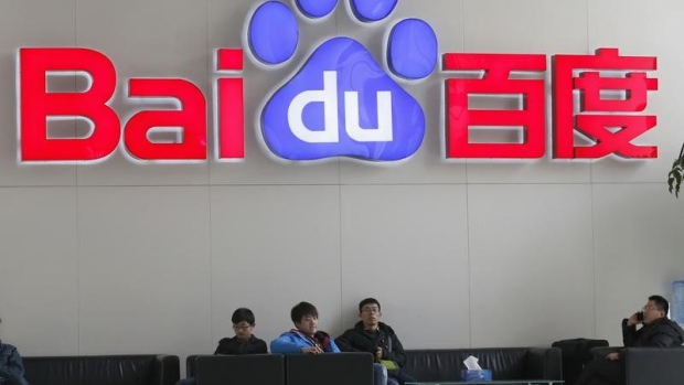 People sit in front of the company logo of Baidu at its headquarters in Beijing article image