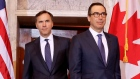 Treasury Secretary Steven Mnuchin walks with Canadian Finance Minister William F. Morneau March 1.