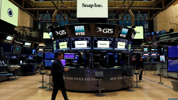 Snap Inc. logos are seen on the floor of the NYSE on the eve of the company's IPO in New York article image