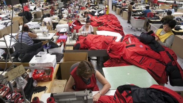 Workers piece together outerwear on the manufacturing floor of Canada Goose's facility in Toronto