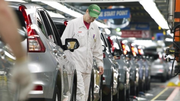 Production Associates inspect cars moving along assembly line at Honda plant in Alliston, Ont.